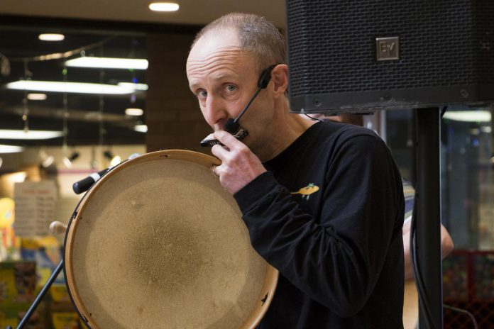 Musician Glen Caradus performed in early 2019 as part of Peterborough Family Literacy Day in Peterborough Square.  On August 7, 2021, the longtime environmental activist will travel 350 kilometers to raise awareness and fund climate-related programs offered by Peterborough GreenUP.  (Photo: Peter Rellinger)