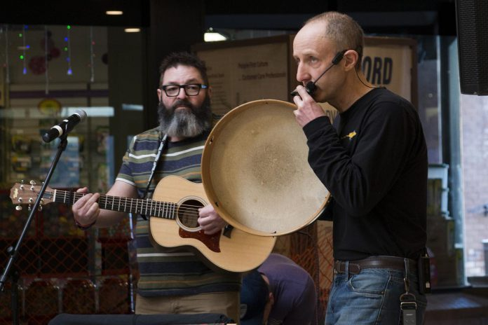 Longtime musical collaborators Phil Stephenson (left) and Glen Caradus presented their popular Paddling Puppeteers show to thousands across the country, including this performance from early 2019 presented as part of the Day of the Family Literacy from Peterborough to Peterborough Square.  (Photo: Peter Rellinger)
