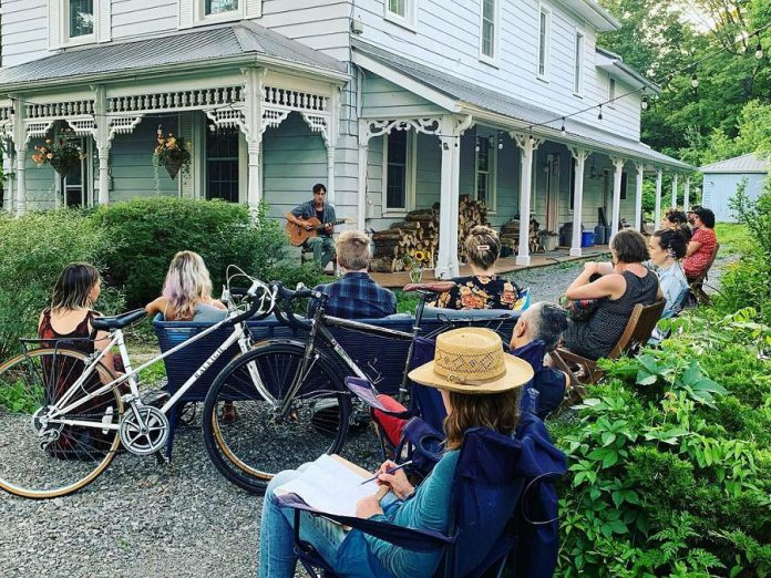 As a pandemic project, Peterborough housemates Tiphaine Lenaik and Rosemary MacAdam launched a series of porch concerts at their Bonaccord Street home last summer. Tiphaine organizes the concerts, while homeowner Rosemary emcees. The series, called 'Waiting for the right porch', is returning this summer with a porch concert every two weeks. Pictured is the July 23, 2021 concert, which featured LA Alfonso, Jake Bartoli, River Jensen, and Kalen Davidson. (Photo courtesy of Tiphaine Lenaik)