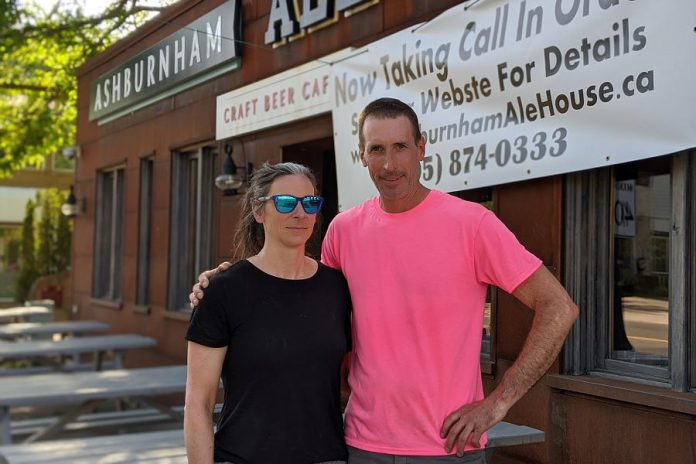 Ashburnham Ale House owners Nollie and Scott Wood, pictured in June 2020 preparing for the reopening of their restaurant's patios during the first pandemic summer. The couple completely renovated the building previously occupied by Fergusons Dry Cleaners and opened the craft beer cafe on June 27, 2013. (Photo: Bruce Head / kawarthaNOW)