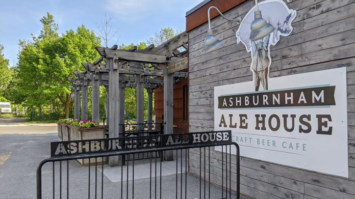 """Ashburnham Ale House's logo pays tribute to Daniel """"Dan"""" Macdonald, a late 19th-century occupant of the original building who became known as """"Peterborough's Strongest Man"""" for lifting heavy objects over his head, including animals like pigs.  (Photo: Bruce Head / kawarthaNOW)"""