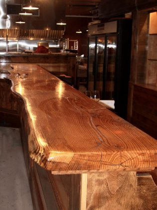 The main bar at Ashburnham Ale House is made of solid oak from Woodview Farm & Forest, just outside of Lindsay. (Photo: Jeannine Taylor / kawarthaNOW)