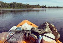 Christine Hoogkamer's kayak loaded with garbage she's collected from the water, as she paddles by the beach at Emily Provincial Park near Omemee. She has an Instagram account called 'Emily Garbage Shark' where she shares photos of the litter she's removed from the environment. (Photo courtesy of Christine Hoogkamer)