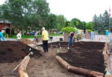 Over three days, 18 volunteers moved 37 cubic yards of material to create this new 100-square-metre Depave Paradise garden in Lakefield, at Winfield Shores Harbour. The goal of Depave Paradise is to use people power to remove pavement and allow rain to soak into the ground where it lands. This reduces localized flooding and improves the health of urban watersheds. (Photo: Genevieve Ramage)