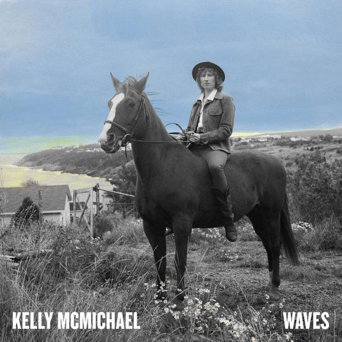 """The cover of Kelly McMichael's first solo album """"Waves"""" features her on a horse with the Atlantic Ocean as a backdrop."""