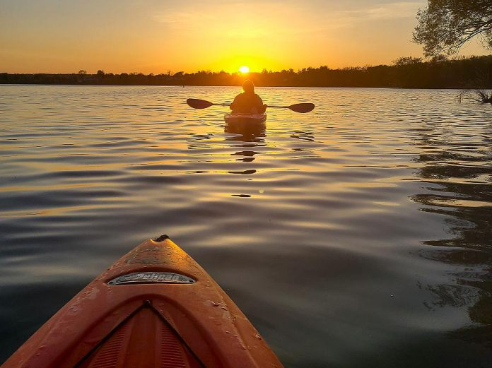 Kayakers enjoy a sunset on Little Lake in Peterborough. Paddling is a physically distanced outdoor recreational activity, and Liftlock Paddle Co. is now offering adult social paddles every Sunday afternoon. (Photo courtesy of Liftlock Paddle Co.)
