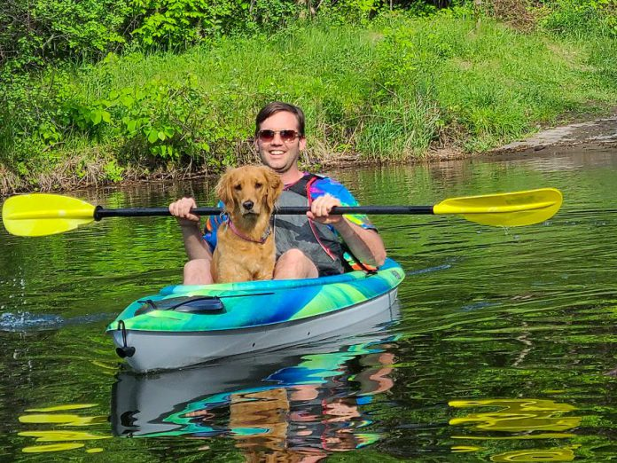 Dogs are welcome when you are renting canoes and kayaks from Liftlock Paddle Co. in Peterborough. Pictured is owner Taryn Grieder's husband Nick with their dog. (Photo courtesy of Liftlock Paddle Co.)