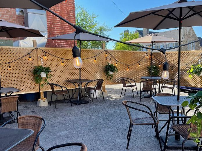 Rare's backlot patio, complete with a fence and lights, is located in the parking lot at the back of the Brock Street restaurant in downtown Peterborough. Rare owners Kassy and Tyler Scott put a lot of work into transforming the space into a patio for outdoor dining, which they will continue to offer even though indoor dining is permitted as of July 16, 2021. (Photo courtesy of Rare)