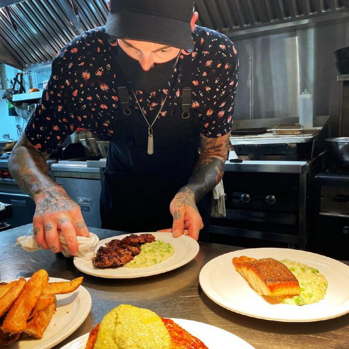Sous-chef Andrew Orde plates dishes at Rare restaurant in downtown Peterborough. Orde, who previously ran brunch at Electric City Bread Company in Peterborough, also takes the lead on Sunday morning brunch at Rare. (Photo courtesy of Rare)