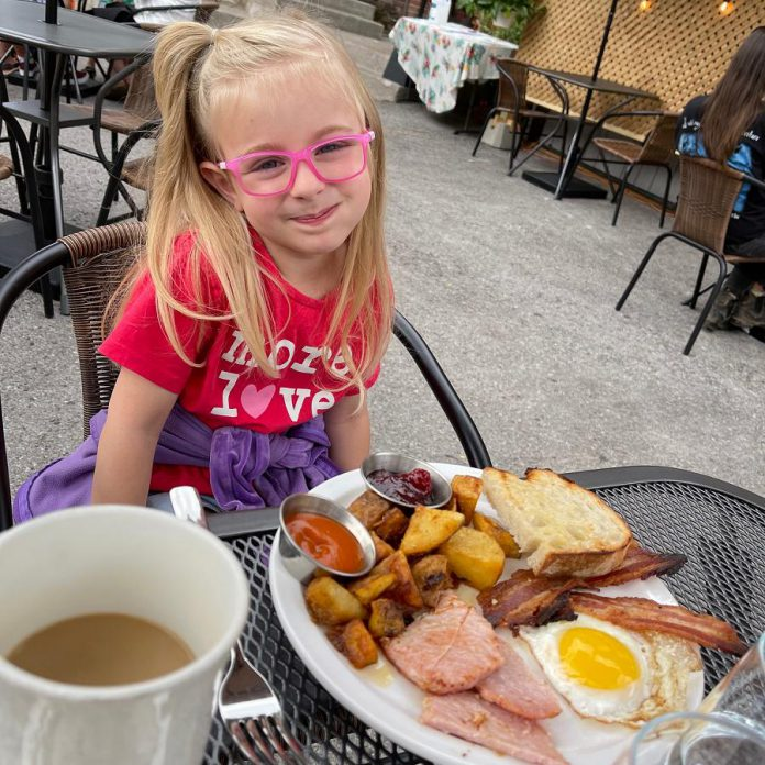 Tyler and Kassy Scott's daughter Isabel enjoys Sunday brunch on the Rare backlot patio. As of July 16, 2021, the Brock Street restaurant in downtown Peterborough is also open for indoor dining.  (Photo courtesy of Rare)