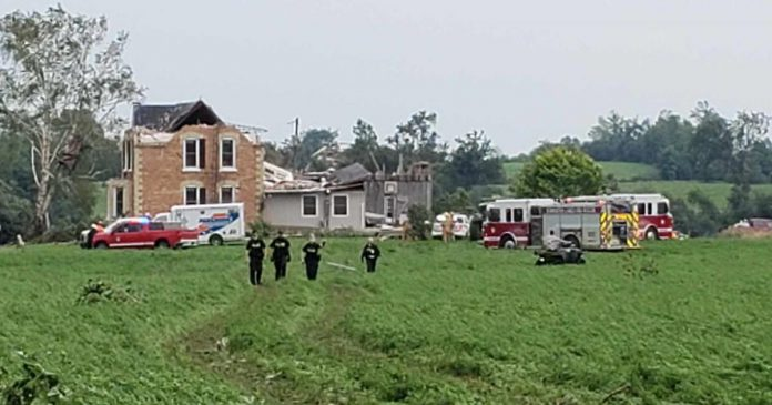 This farm house on Royal Oak Road near Manilla was hit by an apparent tornado on July 15, 2021. Carey Stacey and her son Owen were in the basement helping a cocker spaniel give birth to puppies when the house collapsed, trapping the two in the basement. (OPP-supplied photo)