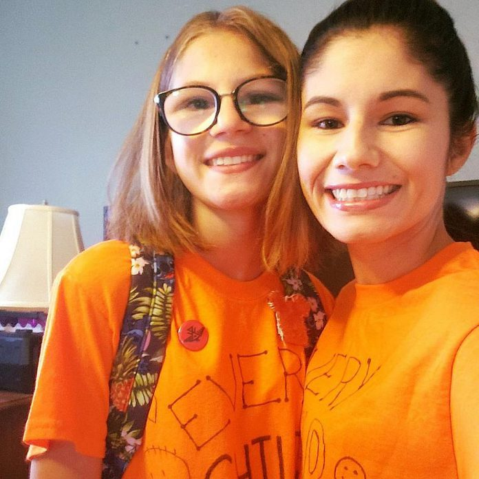 Ashley Wynne and her daughter on Orange Shirt Day, which honours the survivors of Canada's residential school system. Although Wynne had Sage and Sunshine in the works long before the recent discoveries of unmarked graves at former residential schools, Sage and Sunshine comes at a crucial moment for Canada. Wynne says schools like Sage and Sunshine will begin to redress the harm done by the residential school system, which was created for the purpose of stripping Indigenous people of their language and culture. (Photo courtesy of Ashley Wynne)