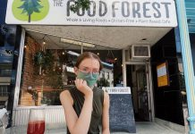 Brianna Wood, sister of The Food Forest's owner Lasair Wood, sits at the single-table patio in front of the vegan restaurant. Thanks to a proposal by landlord Ashburnham Realty, The Food Forest has an additional four tables on a back patio shared with Providence and St Veronus. (Photo: The Food Forest / Facebook)