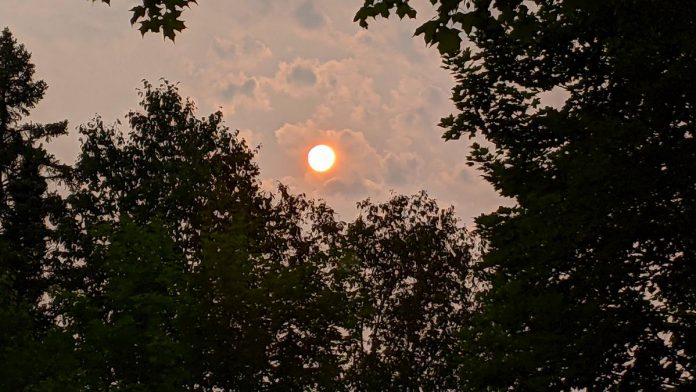 The late afternoon sun appears pinkish orange on July 19, 2021 due to smoke from active forest fires in northwestern Ontario moving over southern Ontario. (Photo: Bruce Head / kawarthaNOW)