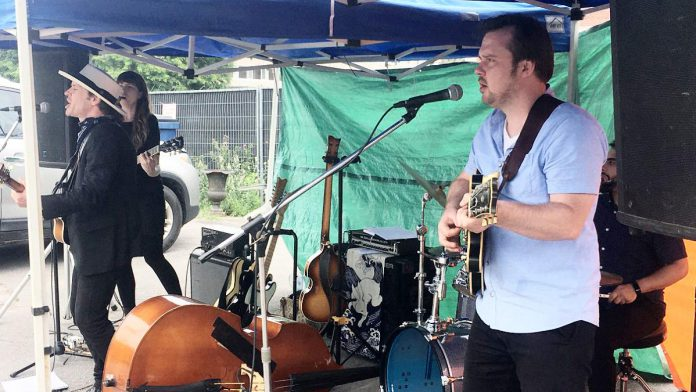 The Weber Brothers band (Emily Burgess, Ryan Weber, Sam Weber, and Marcus Browne) performed at the Peterborough Musicians' Benevolent Association's Deluxe Blues Jam held on July 17, 2021, outside Dr. J's BBQ & Brews in downtown Peterborough. (Photo: Paul Rellinger / kawarthaNOW)