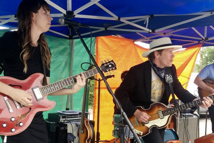 Emily Burgess and Ryan Weber of The Weber Brothers band, which performed at the Peterborough Musicians' Benevolent Association's Deluxe Blues Jam held on July 17, 2021, outside Dr. J's BBQ & Brews in downtown Peterborough. The Weber Brothers released their 13th full-length album in May 2021. (Photo: Paul Rellinger / kawarthaNOW)