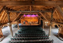 Westben's 'Welcome Back Weekend' starting July 30th will feature concerts on Friday and Saturday night at the new Willow Hill outdoor venue, followed by a concert on Sunday afternoon at Westben's primary performance venue The Barn (pictured). To accommodate pandemic protocols, seating will be limited to 100 people in physically distanced groups. The Barn's massive walls and doors will be rolled away, serving the dual purpose of providing open-air ventilation and allowing guests to experience music and nature at once. (Photo: Wayne Eardley, courtesy of Northumberland County)