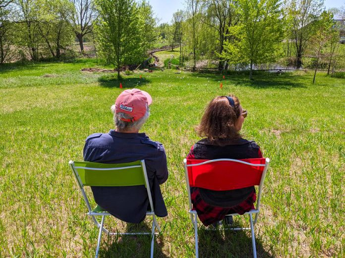 Westben founders Brian Finley and Donna Bennett sit on Willow Hill, a new outdoor performance venue at Westben where guests will enjoy live music in the open air while sitting on their own lawn chairs or blankets. (Photo courtesy of Westben)