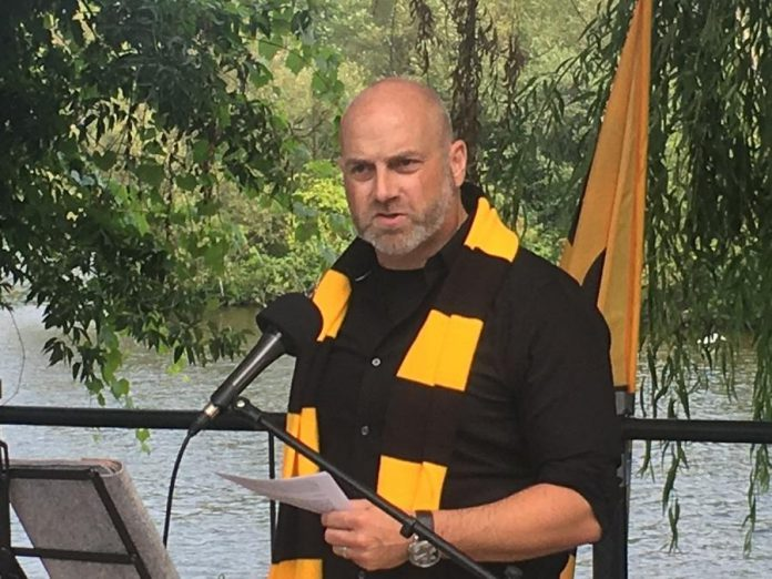 Electric City Football Club president Rob Jenkins, sporting the team's official colours of yellow and black, officially announced Monday (August 9, 2021) at the Silver Bean Café on the shores of Little Lake in Peterborough that the professional soccer franchise will make its League1 Ontario debut in May 2022. (Photo: Paul Rellinger / kawarthaNOW)