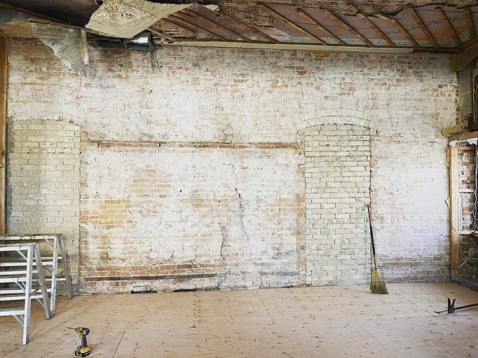 Renovations at The Cow & Sow Eatery have unearthed some of the building's past, including this brick wall that was once part of a historic hotel. (Photo: The Cow & Sow Eatery)
