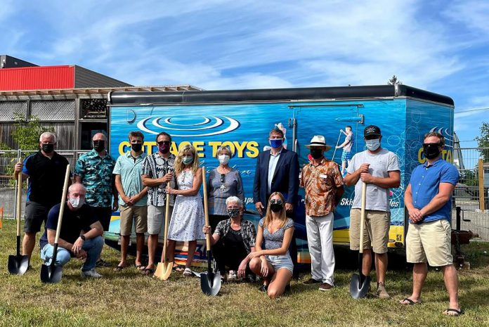 A groundbreaking ceremony for the new retail location of Cottage Toys in Lakefield was held on August 30, 2021. Back row (left to right): ATL Distributing owner Jason Pulchinski, Peterborough Chamber of Commerce president Stu Harrison, Ethan Rork, Andrew Rork, Donna Rork, Deputy Mayor of Selwyn Sherry Senis, Peterborough-Kawartha MPP Dave Smith, Community Futures Board Chair Grant Seabrooke, Tim Fosbery of FourPoints Construction, and Noel Furniss of Diversico Watersports Equipment. Kneeling (left to right): Rob Lamarre of Selwyn Township Building and Planning, Lakefield Ward councillor  Anita Locke, and  Cottage Toys store manager Molly Galvin. (Photo: Cottage Toys)