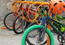 Many schools in Peterborough have front-wheel slot-style racks that are known to cause bike damage and are difficult to lock properly to. A bike rack should provide two points of contact for stability and proper locking. Ring-style bike racks allow two points of contact to properly lock a bike and allow for increased capacity. (Photo courtesy of GreenUP)