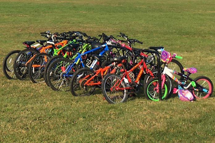 The Active School Travel Peterborough team likes to say that if you add racks, the bikes will fill them. Ideally, bike racks should be sheltered from rain and snow and located near pedestrian traffic areas. (Photo: Leif Einarson)