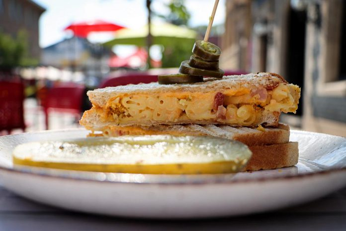 """Sam's Place, one of 18 downtown Peterborough restaurants participating in the first-ever Mac + Cheese Festival during the month of October, is offering a """"Mac and Cheesewich"""" on sourdough bread with American cheddar, jalapeño, bacon, and cheddar mac and cheese with a potato chip crust.  (Photo: Mac + Cheese Festival / Peterborough DBIA)"""