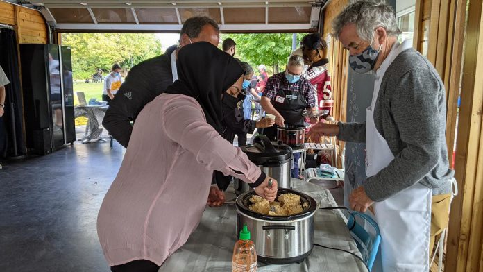 """""""We tried to create a mac 'n' cheese that we think would be appropriate for students."""" Trent University president Dr. Leo Groarke offers up mac 'n' cheese during the launch event on September 21, 2021 for Peterborough's inaugural Mac + Cheese Festival during October.  (Photo: Bruce Head / kawarthaNOW)"""