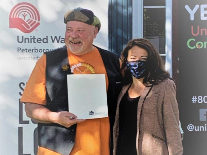 United Way Peterborough & District CEO Jim Russell accepts a proclamation from Peterborough Mayor Diane Therrien recognizing the organization's 80-year commitment to the community during the United Way's 2021-2022 campaign launch on September 29, 2021. (Photo courtesy of United Way Peterborough & District)