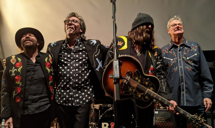 Members of Blackie and the Rodeo Kings take a bow after a sold-out February 21, 2020 performance at Market Hall Performing Arts Centre, one of the final concerts at the downtown performance venue before the pandemic shut down all live music. (Photo: Bruce Head / kawarthaNOW)