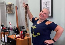 Omemee resident Britney Krzeminsk shows off her new look after having three 28-inch braids of her hair cut off on October 24, 2021 at Glenda's Place Hair Salon in Peterborough. After far exceeding her original fundraising goal by raising $4,100 for the Brain Tumour Foundation of Canada, Britney also had her head shaved. (Photo: Omemee Veterinary Hospital / Facebook)