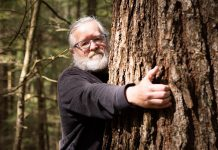 Dr. Peter Quinby, chief scientist with the Peterborough-based non-profit Ancient Forest Exploration & Research, identified the Catchacoma Forest in northern Peterborough County as containing the largest-known stand of old-growth eastern hemlock in Canada. Quinby, along with Katie Krelove of the BC-based non-profit Wilderness Committee and a group of concerned citizens, have been working to protect the old-growth trees from logging. (Photo courtesy of Mitch Bowmile)