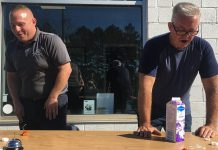 Mark Smith, operations manager of Fitzsimmons Towing and Repair in Peterborough, and retired Peterborough OPP constable Dave McNabb react after eating a ghost pepper in a fundraising event on October 19, 2021 for One City Peterborough, a Peterborough-based organization that is focused on housing, food security, community safety, and inclusion. (Photo: Paul Rellinger / kawarthaNOW)