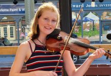 """Peterborough fiddling prodigy Irish Millie (Amelia Shadgett), whose debut album """"Thirteen"""" has been nominated for a 2022 Canadian Folk Music Award, performs at the Black Horse in downtown Peterborough on Wednesday, October 27. (Photo: Irish Millie / Facebook)"""