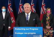 At a Queen's Park media conference on October 22, 2021, Ontario Premier Doug Ford unveiled the government's five-month plan to lift the remaining provincial public health and workplace safety measures. (kawarthaNOW screenshot of CPAC video)