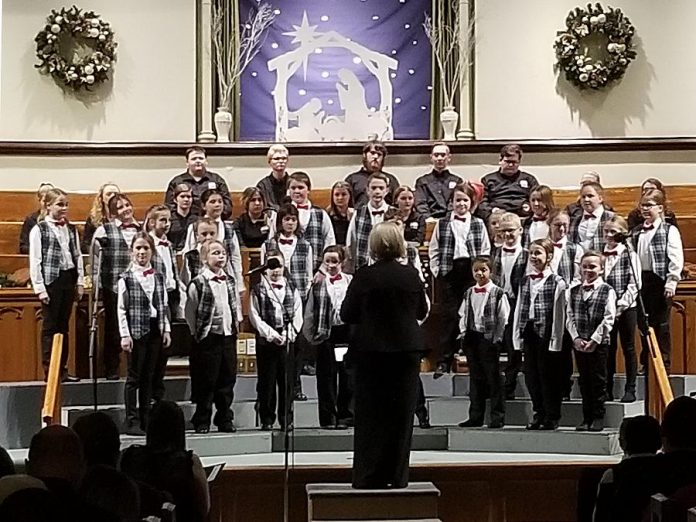 Members of the Peterborough Children's Chorus in performance before the pandemic. The auditioned choir, open to all children and youth from ages 8 to 18 living in Peterborough and the surrounding area, normally sees members experiencing concerts, competitions, opportunities to sing with other choirs, and weekly rehearsals. (Photo courtesy of Peterborough Children's Chorus)