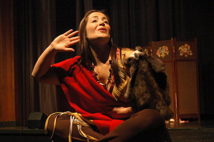 """Indigenous actor-singer Cheri Maracle performing """"Paddle Song"""", a one-woman musical about 1800s Mohawk poet Pauline Johnson written for the stage by Dinah Christie. (Photo supplied by Public Energy)"""
