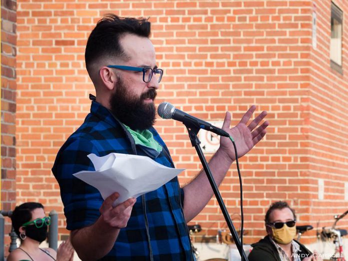 """Justin Million performing at """"An Afternoon of Spoken Word & Poetry #2"""" outside The Theatre on King in downtown Peterborough on November 7, 2020. The event was part of Artsweek SHIFT: Downtown, which Million curated. (Photo: Andy Carroll)"""