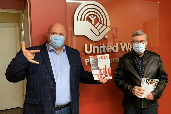 """United Way Peterborough & District released the 16th annual """"Housing is Fundamental"""" report on October 6, 2021. Pictured are CEO Jim Russell along with housing advocate Paul Armstrong, who authored the report. (Photo courtesy of United Way Peterborough & District)"""